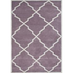 This beautiful rug features New Zealand wool construction with colors of lilac and moon beam. This rug can really tie your room together.