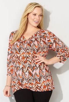 Shop pretty and trendy coral tone tops like our plus size Chevron Drapeneck Top available online at avenue.com. Avenue Store