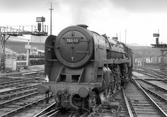 Having just been released from a Cleethorpes service BR7 70040 'Clive of India' is making its way to the Kings Cross loco yard for servicing. Taken 1st July 1962.