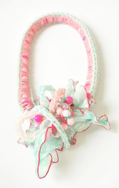 Shana Teugels. Necklace: Candy Beads, 2014. Rubber, polypropylene, polyester, glue, silicone, plastic beads, glass beads, textile paint. 6 x 13 x 32 cm. From series: Polymeringue. Pastel necklace, contemporary jewelry, pink, mint green, plastic necklace, stand necklace, bib necklace