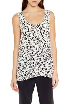 This simple silhouette features a scoop neck & back, relaxed fit and meant to be worn loose and untucked for a relaxed look. Perfect transition piece for layering now and worn as is during the warmer seasons.    Measures: 26 3/4 from shoulder   Kaylen Jungle Spots Tank by Equipment. Clothing - Tops - Tees & Tanks Canada