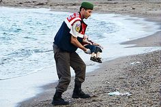 A young boy in a red T-shirt and blue denim shorts encapsulated the human cost of Europe's migrant crisis today when his body was washed up on a Turkish beach after the latest tragedy in the Mediterranean. The toddler was one of at least a dozen people, presumed to be Syrian Kurds, who drowned after their boat capsized as it headed to the Greek island of Kos. A photographer captured his body face-down in the sand near the resort town of Bodrum and the moment this morning when a distraught…