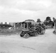 Riflemen of 1st Battalion Royal Ulster Rifles, 6th Airlanding Brigade, UK 6th Airborne Division aboard a jeep and trailer, Normandy, France, 6 Jun 1944; note Horsa glider in background Tonga, D Day Normandy, Normandy France, Normandy Ww2, Parachute Regiment, D Day Landings, Ww2 Pictures, Ww2 Photos, Old Jeep