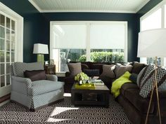 HGTV invites you to see this transitional navy blue living room with gorgeous chocolate brown furnishings.