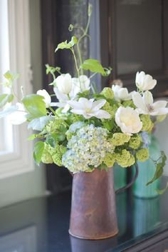 To recreate, place hydrangea, viburnum, peonies, and clematis in copper pitcher. Make sure clematis are higher than rest of arrangement for dimension. Summer Flower Arrangements, Beautiful Flower Arrangements, Flower Centerpieces, Summer Flowers, Fresh Flowers, Flower Decorations, White Flowers, Floral Arrangements, Beautiful Flowers
