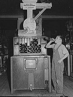 At the height of the Great Depression in October, 1939, Arthur Rothstein was in Lamoille, Iowa, documenting daily life for the Office Of War Information. He stopped by this country store and found a local boy enjoying a cold soda pop.