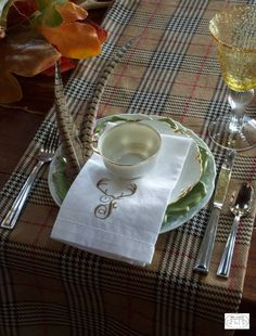This fall table is so sophisticated, thanks to this plaid table runner.