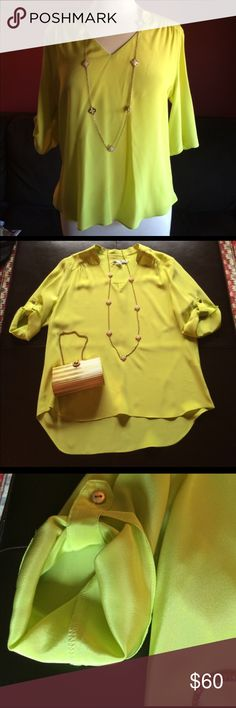 """Amanda Uprichard Silk Blouse Add a pop of color with this lime green 100% silk blouse. The sleeves are 3/4 length and can be rolled up and buttoned. Blouse measures 20"""" inches armpit to armpit, 24""""inches in the front and 28"""" inches in the back. Dry Clean Amanda Uprichard Tops Blouses"""