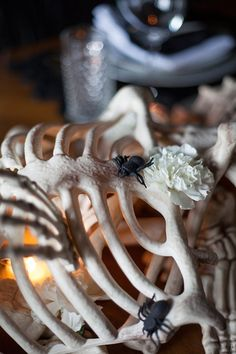 Pin for Later: This Is the Ultimate Halloween Table Runner  To complete the look, she scattered flower heads and fake spiders into the mix.