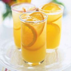 1. In a large pitcher (at least 2 qt.), stir 2 cups orange juice, 1/4 cup lime juice, and 1/4 cup sugar until sugar is dissolved.      2. Add 2 cups ice cubes and 1 liter sparkling water and stir to blend.      3. Pour into tall glasses, adding orange slices if desired.