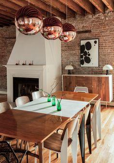 Tom Dixon copper pendants, walnut and white mid-century modern table (circa60.com), Jean Prouve Standard chairs.