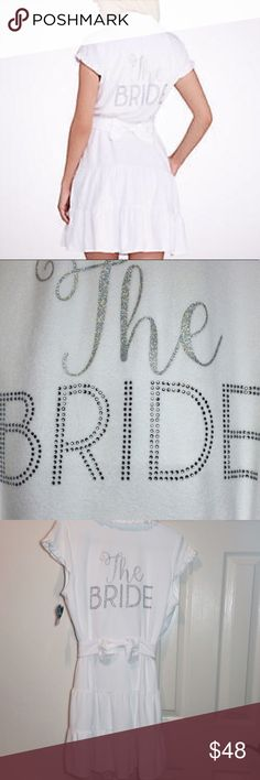 Betsey Johnson THE BRIDE Wedding Robe New with tags. So soft and awesome!!  The perfect gift!!  Luscious white terry robe.  Ties in front and has side pockets. Adorable rhinestones and glitter spell out the word 'The Bride' on the back. Cotton/poly.  Price is firm. Betsey Johnson Intimates & Sleepwear Robes