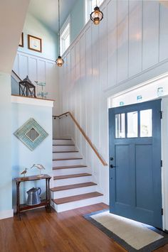 This beach home entry with its batten board and blue door is close to perfection! House of Turquoise: Caldwell and Johnson. Beach Cottage Style, Coastal Cottage, Beach House Decor, Coastal Decor, Home Decor, Coastal Style, Modern Coastal, Cottage Homes, House Of Turquoise