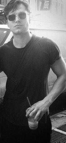 sebastian stan...wish i was the shirt...just clinging to him.