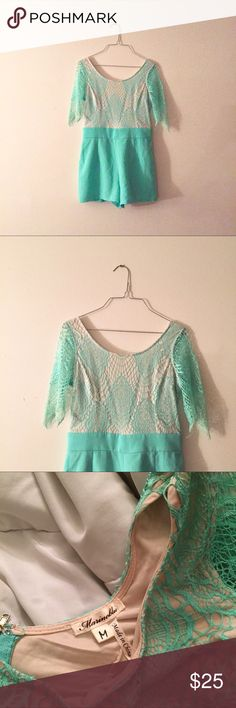 Beautiful Marineblu lace overlay romper Beautiful sea foam green and tan Marineblu romper with lace sleeves and lace overlay top and solid shorts. In excellent condition, worn once. Pair with your favorite statement necklace and wedges or sandals for any upcoming occasion. Could fit a small to a medium. Marineblu Pants Jumpsuits & Rompers
