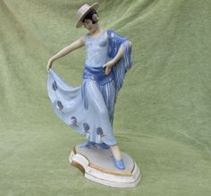 Beautifully hand painted Czech ceramic dancer, made by the Royal Dux factory and designed by (and signed) Schaff. Under the base are the Czech stamps and a pink Royal Dux triangle