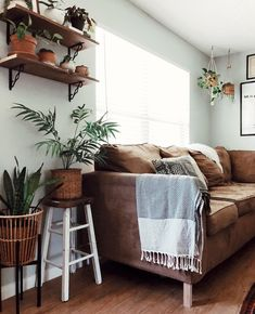 Boho decor + style, neutral colors and greenery.
