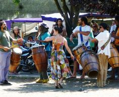"""""""A local fair with drum circle dancing... when the hand drums begin... the dancers will appear..."""""""