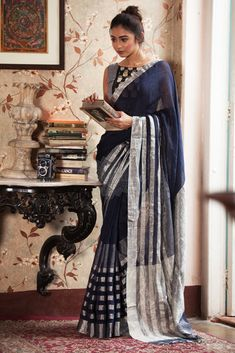 Add a dash of dazzle to the earthen tapestry of linen fabric with the zari embellishments. The bold navy blue accent gives a touch of reality to the surreal tex
