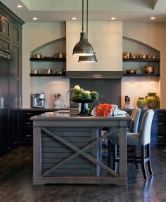 "Kitchen! Love this island with the ""x"" detail and paneling. Dark cabinets, darker wood floor. Pretty rustic chic. Also love the pendant lights."