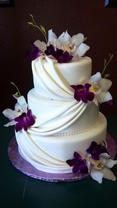 White and purple wedding cake www.cakedesignslv.com