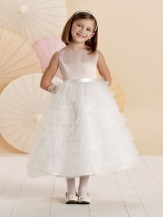 Joan Calabrese for Mon Cheri - 110306 - Sleeveless satin, tulle and organza tea-length A-line dress with satin ribbon tie at natural waist, multi-tiered and ruffled tulle full skirt.Also available in baby sizes 6 mos. - 24 mos. as 110306B, also in Pink/Ivory.Sizes: 2 - 16Colors: Champagne/Ivory, Ivory/Blush, White, Ivory
