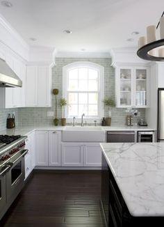 Kitchen Ideas: Farm Sinks Light green subway tile, dark floors
