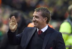 Liverpool's Northern Irish manager  Brendan Rodgers arrives for the English Premier League football match between Liverpool and Arsenal at Anfield in Liverpool, Northwest England, on December 21, 2014.