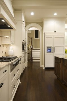 floor color, stainless steel, white cupboards, whole feel.