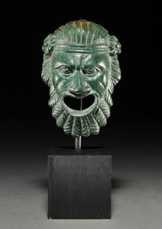 ROMAN BRONZE THEATER MASK APPLIQUE. Dionysiac bearded head; headdress with berries. Rich green patina. 1st Century BC/AD