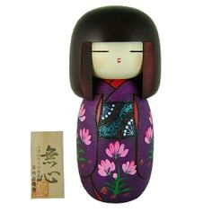 beautiful purple kokeshi doll