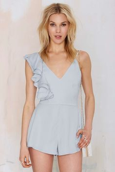 Style Stalker Bianco Ruffled Romper in Light Blue.