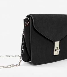 Crossbody bag in suede with chain and suede strap.  Find out more by clicking on the link