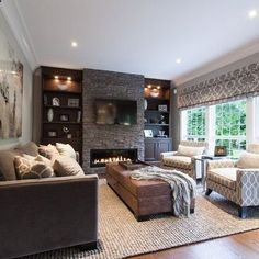 Bright craftsman style living room with dark stone feature wall