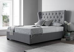 The Salerno winged bed is sure to bring a sense of grandeur and style to your bedroom. Upholstered in woven cool grey fabric. The generously proportioned Salerno bed fuses contemporary design with inspiration from classical Chesterfield buttoned designs.  The gentle curved wings create a design which is highly individual and will form an elegant focal point in your bedroom.  The bed comes complete with a sprung slatted base for extra comfort and support.  Should you require a fabric sample…