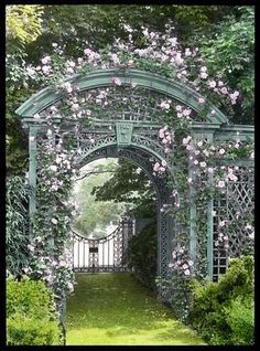 Pink flowers on a dusty green arbor. So romantic. See more ideas http://thegardeningcook.com/garden-arbors/