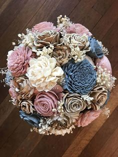 Dusty blue and rose sola flower bouquet, wedding flowers Beautifully natural sola wood flower bouquet hand dyed in shades of dusty blue, dusty rose and champagne. This bouquet is full of a variety of sola blooms and accented with dry babies breath and filler. The wire stems are