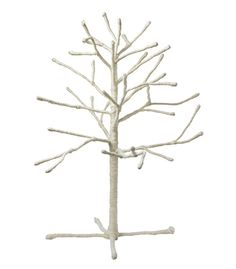 """I'm not a fan of artificial trees, but this """"tabletop"""" tree from Arcadia Home is lovely.  24""""."""