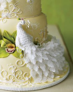 Winged Victory    Cake designer Flora Aghababyan created a pair of peacocks (a second, not shown, sits on top) to signify the bond between bride and groom. And considering that each tiny tail feather is handmade, this cake—perfect for a garden wedding—is a true labor of love.  -