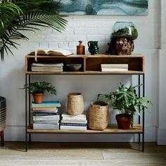 Excellent in large or small spaces (we like it in the entryway or behind the couch), our Industrial Storage Open Console boasts a slim cubby to stash mail, keys, gloves or whatever else you want to keep handy.