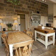 Egton Cottage, Yorkshire The gorgeous cottage kitchen in Egton - beautiful rustic style with flagstone flooring and chunky shabby chic furniture. Love this modern take on a rustic country kitchen Rustic Chic Kitchen, Stylish Kitchen, Country Kitchen, New Kitchen, Farmhouse Chic, Kitchen Island, Kitchen Tips, Kitchen Interior, Kitchen Brick