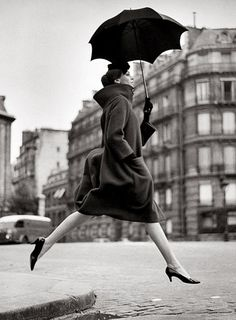 Richard Avedon | Homage to Munkacsi, Carmen, coat by Cardin, Place Francois-Premier, Paris, August 1957