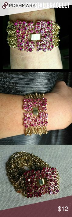 New Hot Pink Multi-Chain Bracelet Gorgeous hot pink crystal multi-strand fashion chain bracelet from my boutique. Still in packaging. Has a total of 21 gold chains. Measures 7 inches long x 1.25 inches wide. Center clasp. Thank you for visiting my closet ❤ Jewelry Bracelets