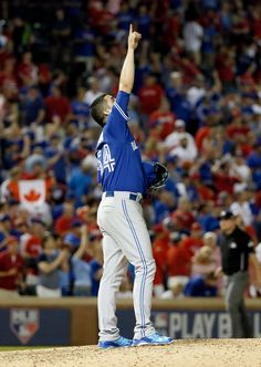 Toronto Blue Jays relief pitcher Roberto Osuna celebrates after the Blue Jays win against the Texas Rangers in Game 3 of baseball's American League Division Series in Arlington, Texas on Sunday, Oct. Sports Baseball, Baseball Jerseys, Sports Teams, Baseball Toronto, Basketball T Shirt Designs, Mlb Postseason, American League, Toronto Blue Jays, Go Blue