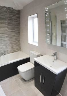 Fully Tiled Small En Suite With Glass Border With Bathroom