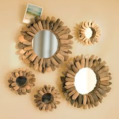 Instead of spending a lot of money, you can totally make this.   1. Go to the dollar store. Buy a couple of mirrors that are different sizes.  2. While you're there, buy packs of freeze pop sticks.  3. Go home. And heat up your hot glue gun!   4. Take your mirrors and make a first layer of wooden sticks, and let the glue dry. And then after they dry make a second layer... BAM... stick mirrors :)