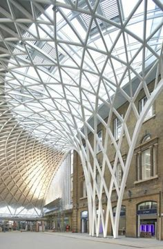 19th C: Gothic Revival (?) Archi-Europe A semi-circular vaulted concourse designed by British architects John McAslan + Partners will open at King's Cross Station in London next week. The architects, who have been progressing a masterplan for the railway station since 1998, have fully restored the five buildings that comprise the western elevation to serve as a backdrop to the new glazed entrance hall.