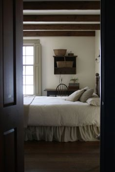 Most shaker homes I found were white (rather than wood) but this is a good reference for the simplicity of the style.. it's edited to black/ white/ gray and natural wood