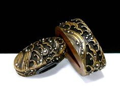 Brass wave Fuchi Kashira from the collection of David W. Easley