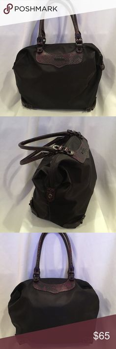"Rebecca Minkoff black Nylon tote bag Nice in like brand new condition Rebecca Minkoff Black nylon tote/travel  bag with reddish purple Faux snakeskin handle and accents  . Zip closure and 1 inside zip pocket dimensions- 14"" length 11"" height 6"" depth 8"" strap drop Rebecca Minkoff Bags Totes"